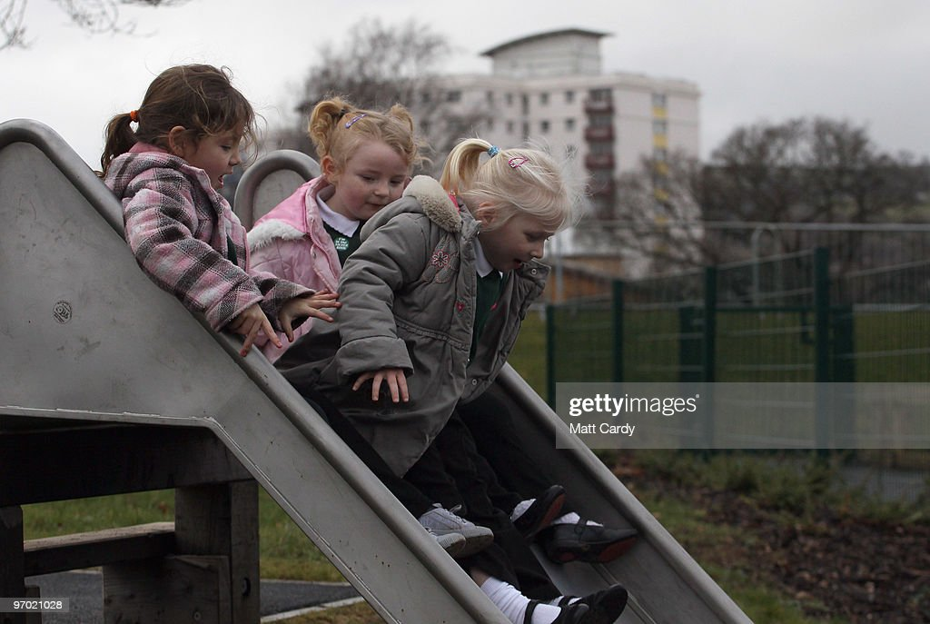 Primary school pupils at the Bridge Learning Campus play on a slide in the playground at the school on February 24, 2010 in Bristol, England. The 40million GBP campus in Hartcliffe, Bristol, was constructed as part of the Government's Building Schools for the Future programme and opened in January 2009. It now offers over 800 pupils a life long provision of learning from nursery, reception and primary to secondary and post-16 education. As the UK gears up for one of the most hotly contested general elections in recent history it is expected that that the economy, immigration, the NHS and education are likely to form the basis of many of the debates.