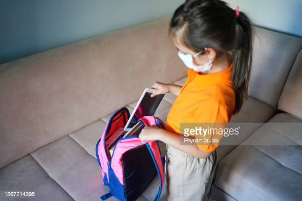 primary school student preparing the backpack - middle east stock pictures, royalty-free photos & images