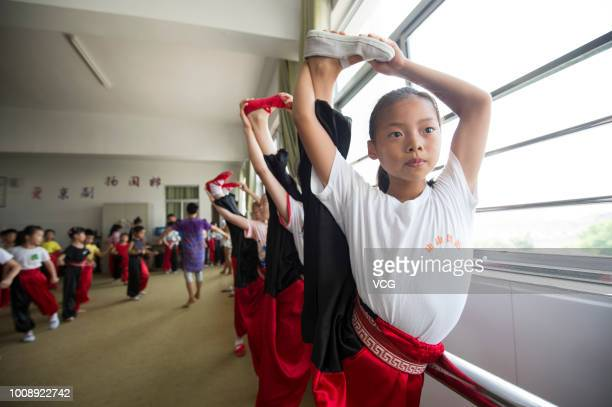 Primary school students learn Peking Opera during their summer holiday on July 28 2018 in Haian Jiangsu Province of China To promote Peking Opera...