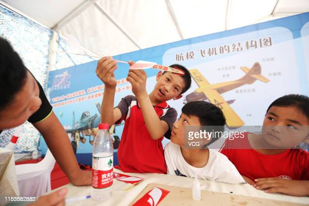 Primary school students of Hua County make an aircraft model during the opening ceremony of the 11th Anyang Air Sports Culture and Tourism Festival...