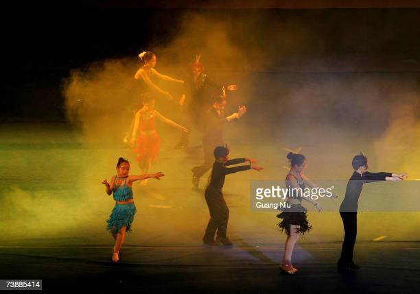 Primary school students perform a Latin dance during an 'Olympic Soul Happiness' activity to promote Olympic education April 14 2007 in Beijing China...