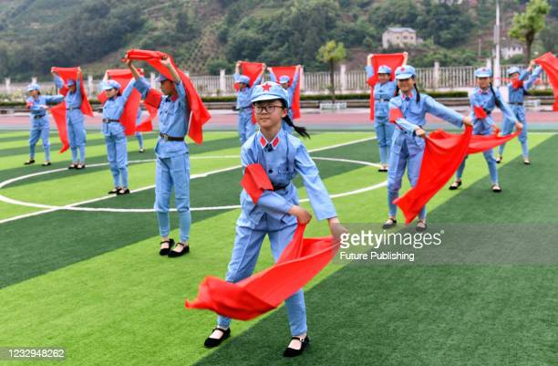 Primary school students perform songs and dances to celebrate the 100th anniversary of the founding of the Communist Party of China in Yichang,...