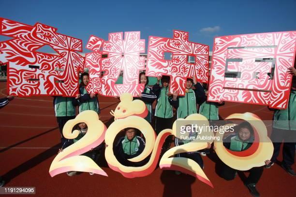 YANGZHOU CHINA DECEMBER 31 2019 Primary school students put the colorful dragon in 2020 Yangzhou City Jiangsu Province China December 31 2019...