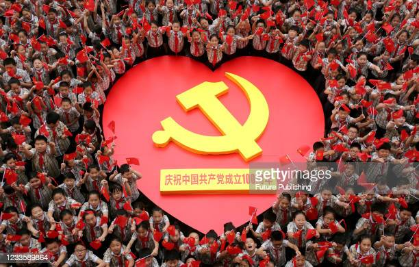 Primary school students sing together to celebrate the 100th anniversary of the founding of the Communist Party of China in Zaozhuang, Shandong...