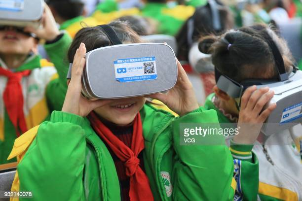 Primary school students wear virtual reality glasses while learning about science in a classroom on March 14 2018 in Xiangxi Tujia and Miao...