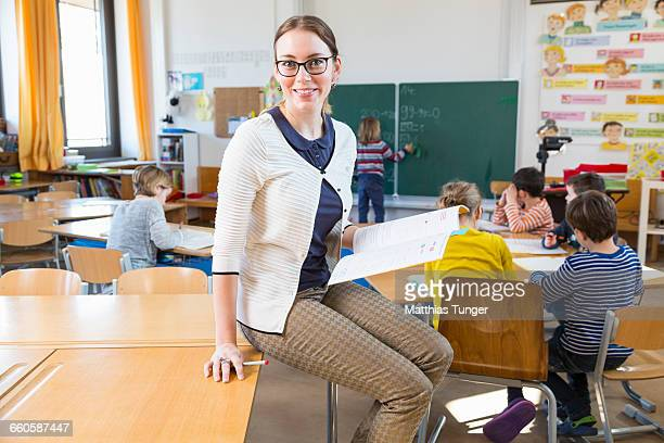 primary school teacher in front of her class