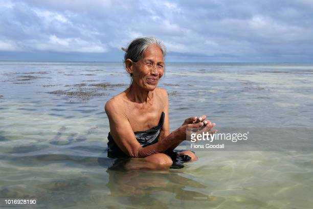 Primary school teacher Valo Talava collects Panea shells from the lagoon for dinner on August 15 2018 in Funafuti Tuvalu The small South Pacific...
