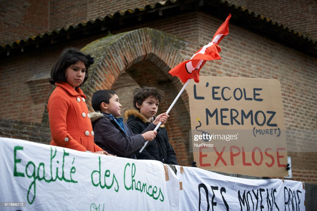 Primary school teachers gathered in front of the Prefecture in Toulouse, France on February 13th 2018. They protest against the lack of money, the classes with too many children and the new reform of Education Minister J.-M. Blanquer. A child holds a trade union'flag under a banner reading 'Equal opportunities'.