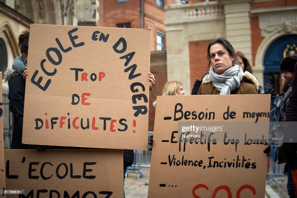 Primary school teachers gathered in front of the Prefecture in Toulouse, France on February 13th 2018. They protest against the lack of money, the classes with too many children and the new reform of Education Minister J.-M. Blanquer. Primary school teachers listen to a trade unionist and hold placard reading 'Scool in danger, too much difficulties'.