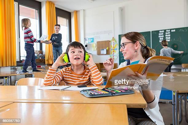 primary schoolboy wearing ear protectors