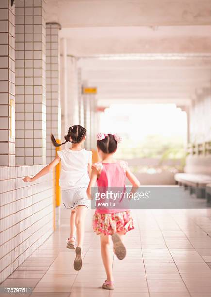 Primary Schoolchildren Running Outside Classroom