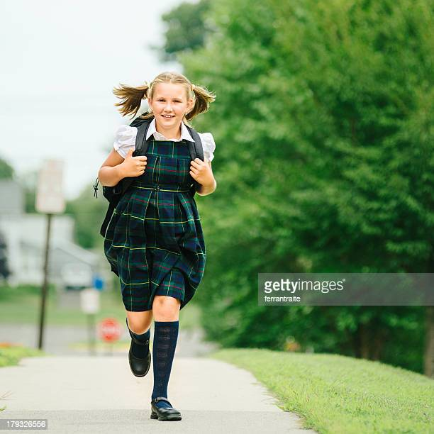 Primary Schoolgirl running to school