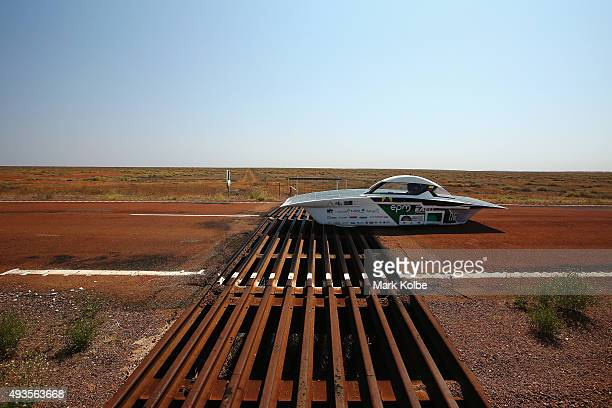 Primavera of EAFITEPM Solar Car Team Colombia crosses a cattle grid as it races in the Challenger Class on October 21 2015 outside of Coober Pedy...