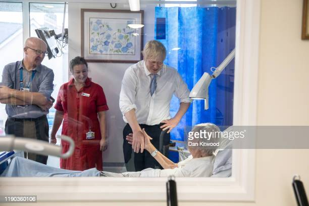 Prime Minister and Conservative Party leader Boris Johnson speaks to patient Andrew Hall as he visits West Cornwall Community hospital on November 27...