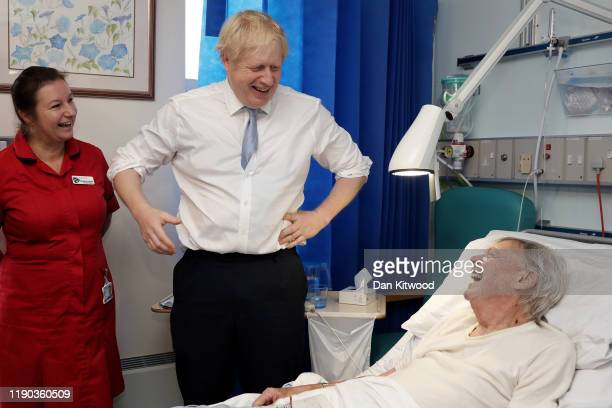 Prime Minister and Conservative Party leader, Boris Johnson speaks to patient Andrew Hall as he visits West Cornwall Community hospital on November...