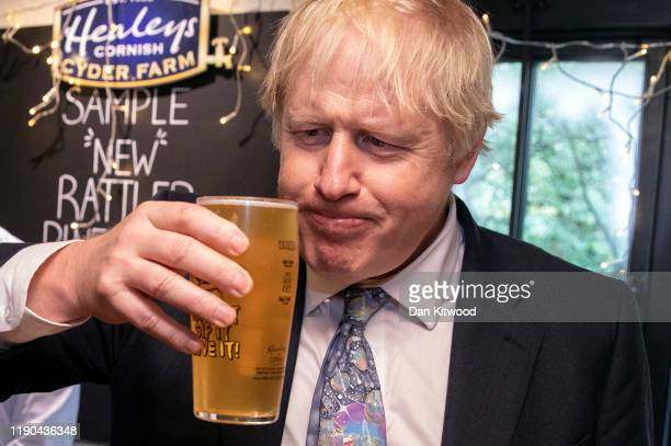 Prime Minister and Conservative Party leader, Boris Johnson tries some cider as he visits Healey's Cornish Cyder Farm on November 27, 2019 in...