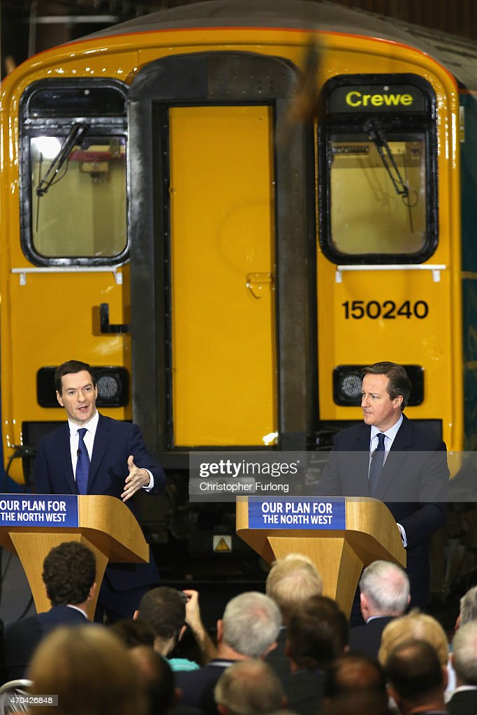 Prime Minister and leader of the Conservative Party, David Cameron (R) and Chancellor George Osborne address guests and supporters during a visit to Arriva Traincare on April 20, 2015 in Crewe, England. During the visit Cameron and Osborne spoke of their concerns and the impact of SNP policies on the whole of the United Kingdom.