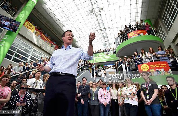 Prime Minister and leader of the Conservative Party David Cameron addresses workers at the head office of supermarket giant Asda on May 1 2015 in...