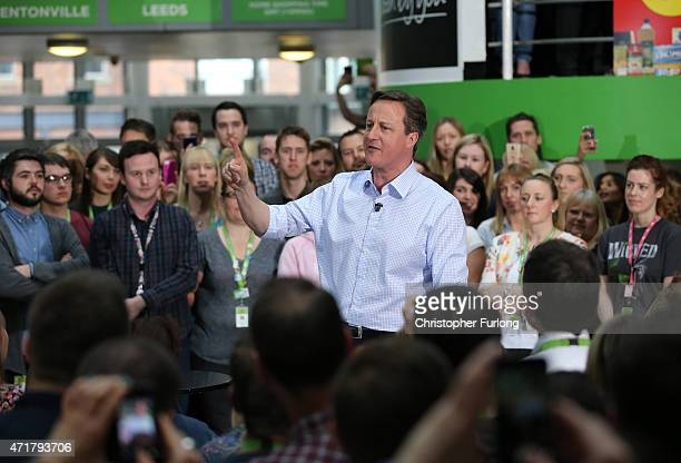 Prime Minister and leader of the conservatives David Cameron addresses workers at the head office of supermarket giant Asda on May 1 2015 in Leeds...