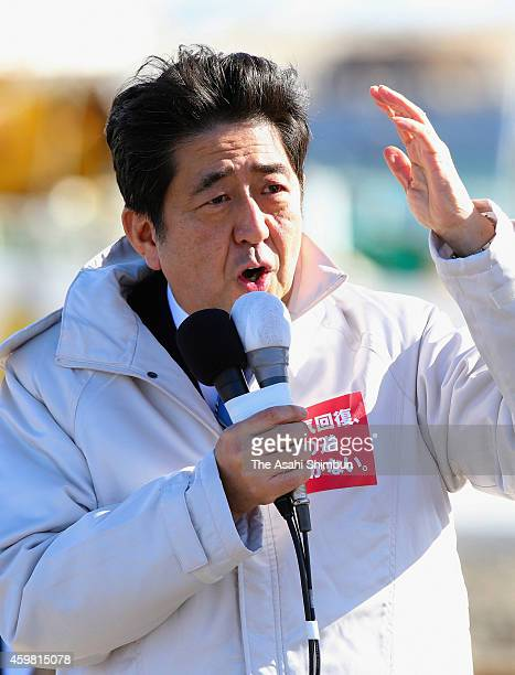 Prime Minister and Liberal Democratic Party President Shinzo Abe makes a street speech as the lower house election campaign officially kicks off on...