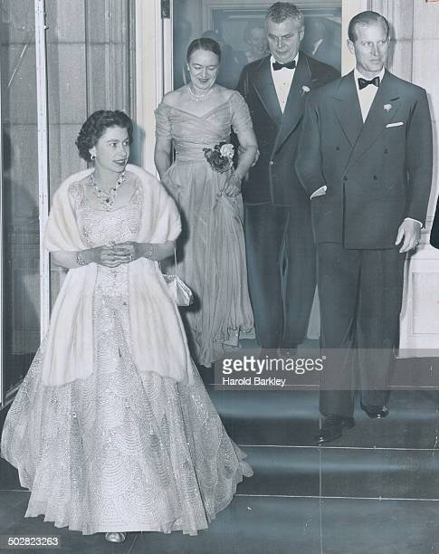 Prime Minister and Mrs Diefenbaker accompany the Queen and Prince Philip to the door as they leave private dinner last night after staying an hour...
