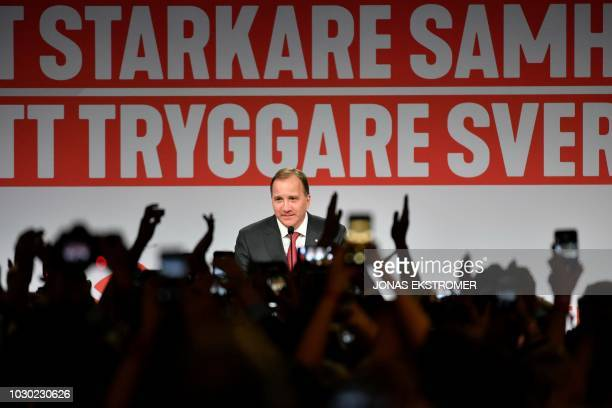 TOPSHOT Prime minister and party leader of the Social democrat party Stefan Lofven addresses supporters at an election night party following general...