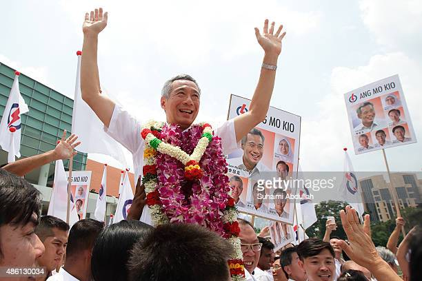 Prime Minister and People's Action Party Secretary General Lee Hsien Loong reacts with party supporters after nomination is closed at Raffles...