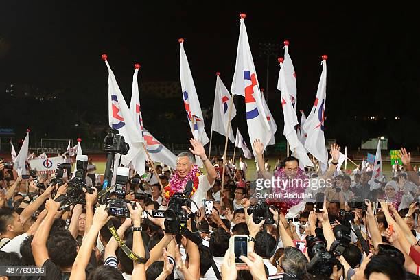 Prime Minister and People's Action Party Secretary General Lee Hsien Loong and Dr Koh Poh Koon celebrate after winning their seat for Ang Mo Kio...