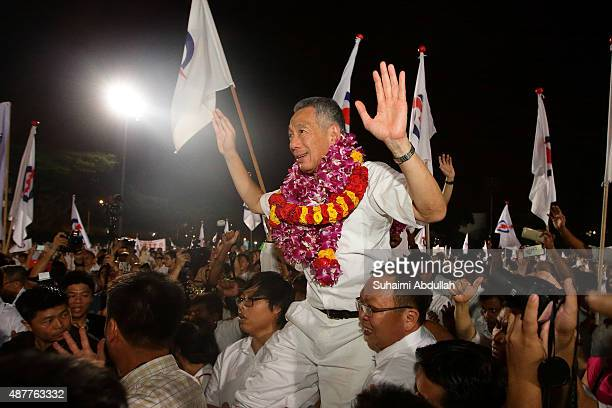 Prime Minister and People's Action Party Secretary General Lee Hsien Loong celebrates after winning his seat for Ang Mo Kio Group Representation...