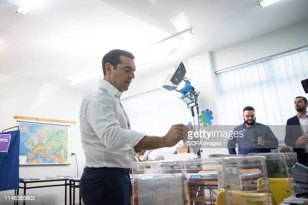 Prime Minister and President of Syriza Alexis Tsipras seen casting his vote during the Regional Government Municipality and European Parliament...