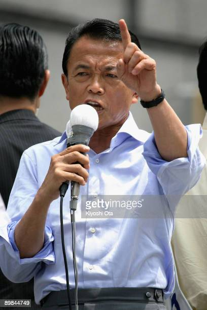 Prime Minister and President of the Liberal Democratic Party Taro Aso delivers a stump speech during an election campaign in front of Hachioji...