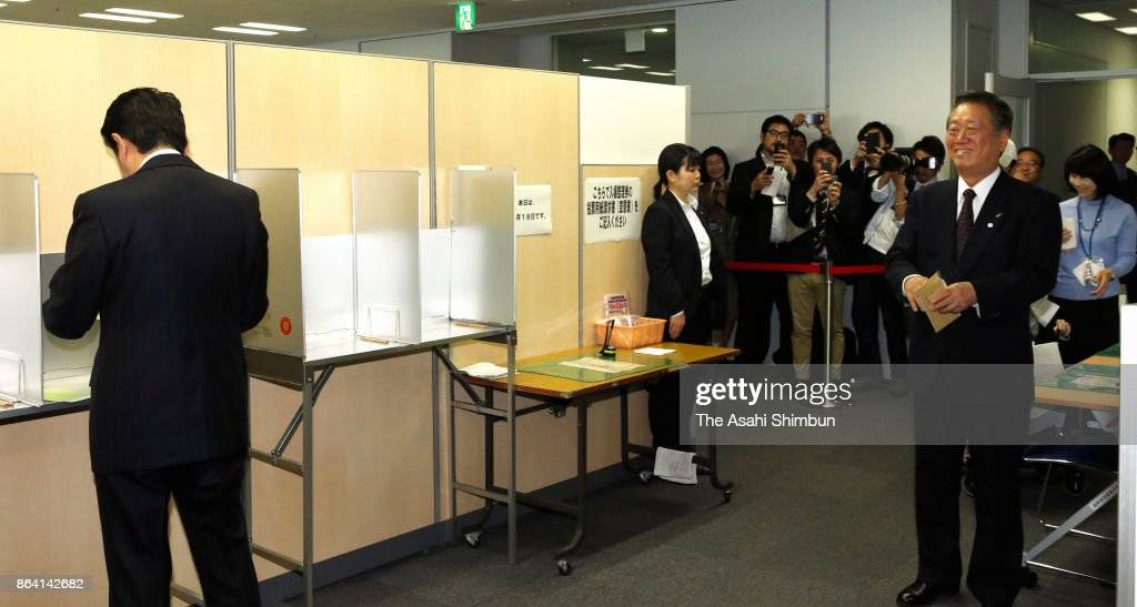 Prime Minister and ruling Liberal Democratic Party President Shinzo Abe (L) and Liberal Party leader Ichiro Ozawa (R) are seen at a polling station for absentee vote on October 18, 2017 in Tokyo, Japan. Japanese vote in the general election on October 22.