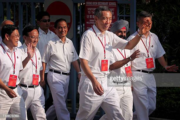 Prime Minister and the Secretary General of the People's Action Party Lee Hsien Loong arrives at a polling station on May 7 2011 in Singapore 221...
