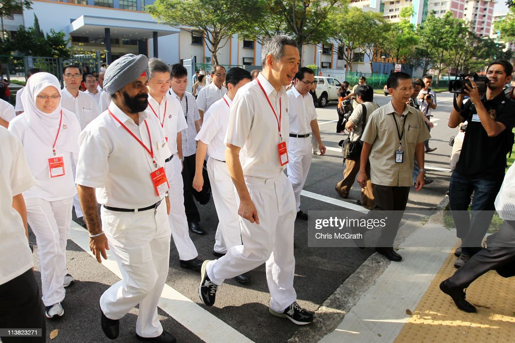 Prime Minister and the Secretary General of the People's Action Party, Lee Hsien Loong (C) leaves after casting his vote at a polling station on May 7, 2011 in Singapore. 2.21 million voters are expected to visit polling stations across Singapore, in the countries 11th elections since independence. The 2011 general election has been the most contested in Singapore's history with 82 seats out of 87 being contested. In 2006 the People's Action Party (PAP) received 66.6 per cent of the vote.