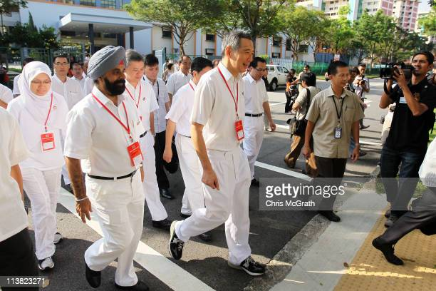 Prime Minister and the Secretary General of the People's Action Party Lee Hsien Loong leaves after casting his vote at a polling station on May 7...