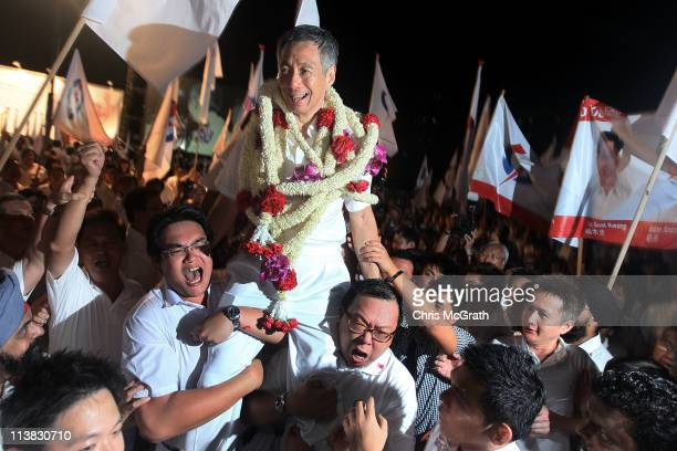Prime Minister and the Secretary General of the People's Action Party Lee Hsien Loong is carried out of the Toa Payoh stadium after winning his seat...