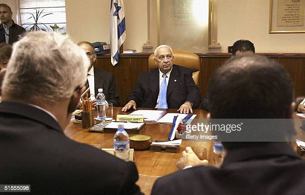 Prime Minister Ariel Shaorn looks around to his ministers including Foreign Minister Silvan Shalom and Finance Minister Benjamin Netanyahu as he...