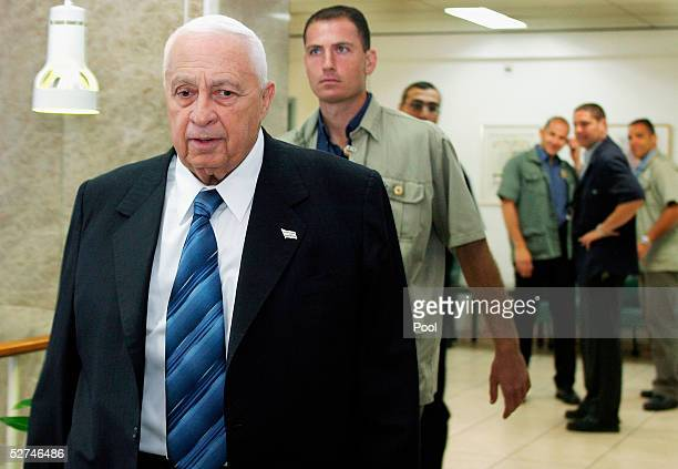 Prime Minister Ariel Sharon walks through the halls of his Jerusalem offices with security agents on the way to chair a cabinet meeting on May 2 2005...