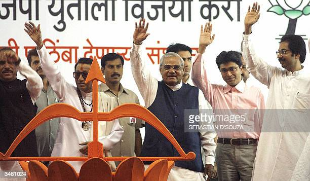 Prime Minister Atal Behari Vajpayee right wing Shiv Sena leader Bal Thackeray along with party members wave to the crowd during a election rally in...