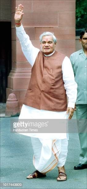Prime Minister Atal Bihari Vajpayee waves as he arrives for the monsoon session at Parliament House on July 23 2001 in New Delhi India