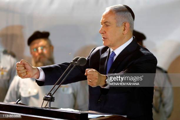 Prime Minister Benjamin Netanyahu attends the funeral of Sergeant First Class Zachary Baumel at the Mount Herzl military cemetery in Jerusalem on...