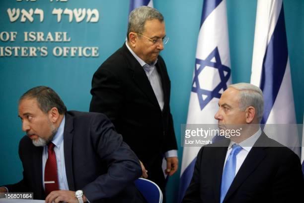 Prime Minister Benjamin Netanyahu looks on beside Defence Minister Ehud Barak and Foreign Minister Avigdor Liberman during a joint press conference...