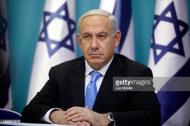 Prime Minister Benjamin Netanyahu looks on during a joint press conference with Foreign Minister Avigdor Liberman and Defence Minister Ehud Barak on...