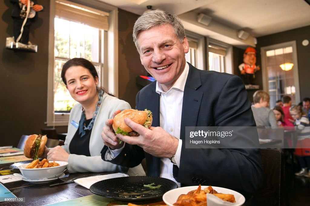 Prime Minister Bill English andf Wellington Central candidate Nicola Willis taste test the 'Bill English Burger' at The Backbencher gastropub on August 12, 2017 in Wellington, New Zealand. Prime Minister Bill English is only just ahead as preferred prime minister, with Labour's new leader Jacinda Ardern 1.4 points behind. Labour has enjoyed a surge in support in the last week, following Jacinda Ardern taking over from Andrew Little as party leader on 1 August.