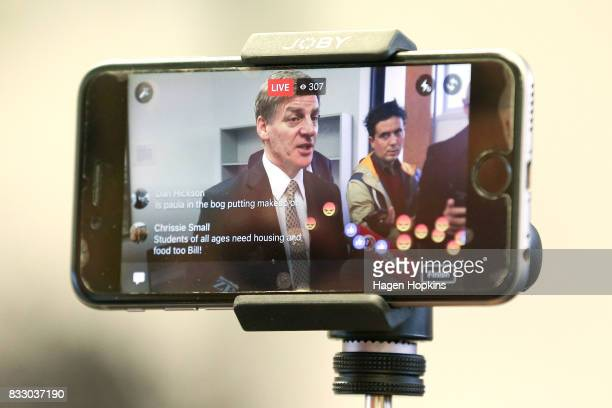 Prime Minister Bill English is filmed on Facebook Live at a press conference during a visit to JOBfest on August 17 2017 in Wellington New Zealand...
