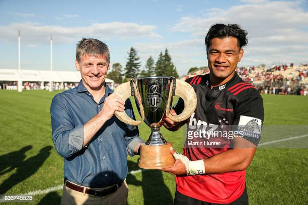 Prime Minister Bill English presents the Farmers Cup to Jordan Taufua of the Crusaders after the preseason Super Rugby match between the Crusaders...