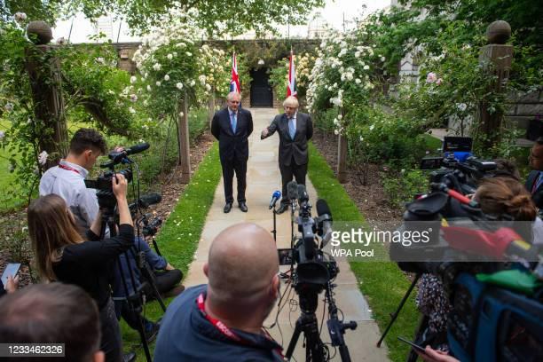 Prime Minister Boris Johnson and Australian Prime Minister Scott Morrison speak to media in the garden of 10 Downing Street, after agreeing the broad...