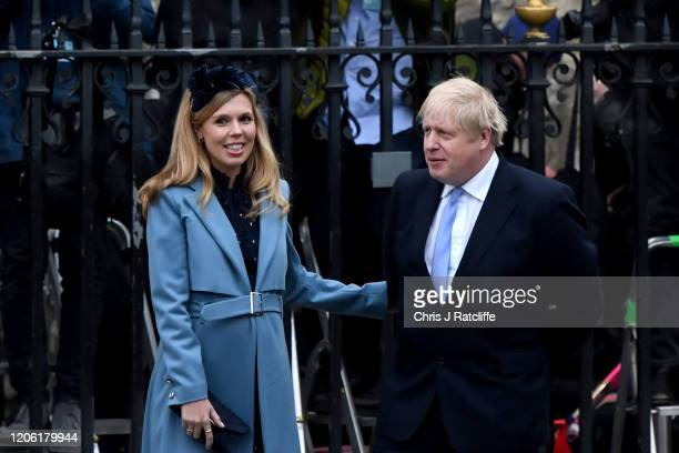 Prime Minister Boris Johnson and Carrie Symonds arrive to attend the annual Commonwealth Day Service at Westminster Abbey on March 9 2020 in London...