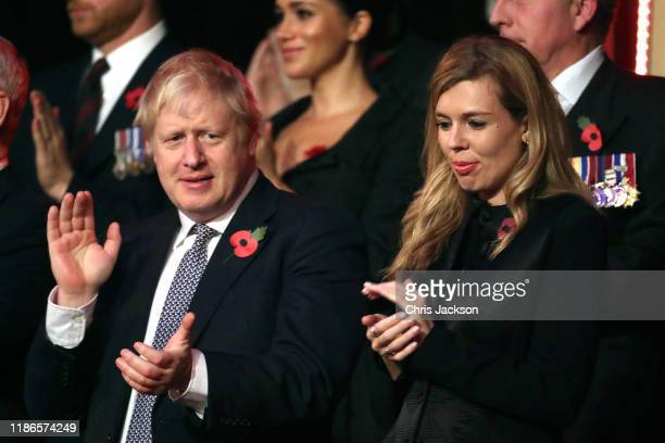 Prime Minister Boris Johnson and Carrie Symonds attend the annual Royal British Legion Festival of Remembrance at the Royal Albert Hall on November...