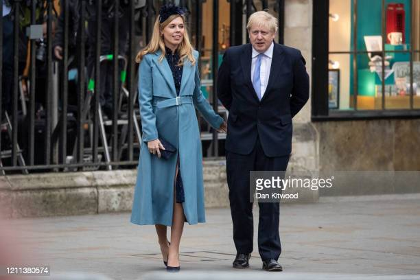 Prime Minister Boris Johnson and Carrie Symonds leave after attending the annual Commonwealth Day Service at Westminster Abbey on March 9, 2020 in...